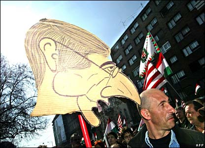 Protester with cardboard cutout of Prime Minister Ferenc Gyurcsany
