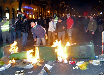 Protesters burn barricades made out of rubbish bins