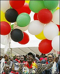 Zimbabwean President Robert Mugabe releases balloons during his birthday celebrations