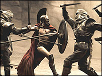Spartan warrior fights Persian foes in the film 300, courtesy of Warner Brothers