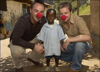 Ant McPartlin and Declan Donnelly with a child in Kenya's Kibera slum