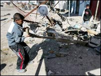 Boy inspects bomb damage last month