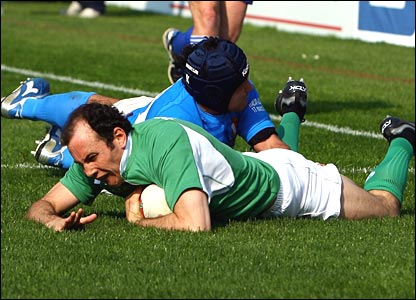 Ireland's Girvan Dempsey scores the game's first try