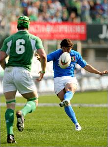 Italy's Ramiro Pez scores a drop-goal