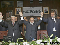 Palestinian Authority President Mahmoud Abbas (L), Prime Minister Ismail Haniya (R) and Ahmad Bahar, Deputy Speaker of Parliament