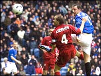 Kris Boyd towers above Russell Anderson to give Rangers the lead