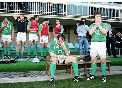 The Irish bench look worried after Italy's late try