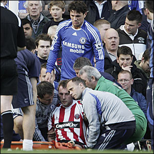 Rob Hulse receives treatment on the pitch