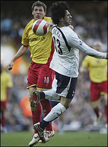 Darius Henderson of Watford goes for the ball with Ricardo Rocha of Tottenham