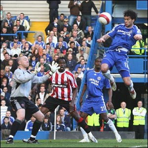 Michael Ballack jumps up to head past Blades keeper Paddy Kenny