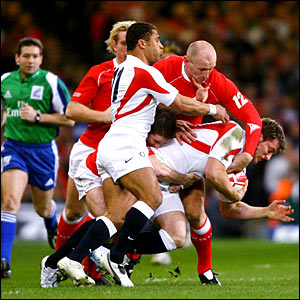 Wales captain Gareth Thomas tackles England's Mark Cueto