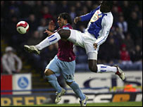 West Ham's Carlos Tevez and Blackburn's Christopher Samba