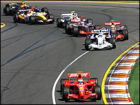 Kimi Raikkonen's Ferrari takes up the position he was never to lose at the start of the Australian Grand Prix