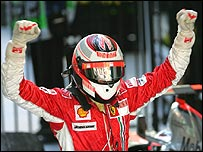 Kimi Raikkonen celebrates winning his first race for Ferrari