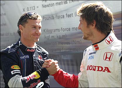 Scot David Coulthard and his friend the Englishman Jenson Button shake hands before the start of the Australian Grand Prix