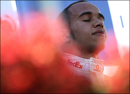 Lewis Hamilton closes his eyes and enjoys a moment of peace on the podium of the Australian Grand Prix