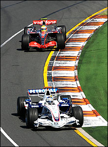 BMW Sauber's Nick Heidfeld leads Lewis Hamilton's McLaren in the early stages of the Australian Grand Prix
