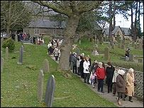 Parishioners leaving the service