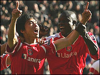 Zheng Zie, left, celebrates with Darren Bent