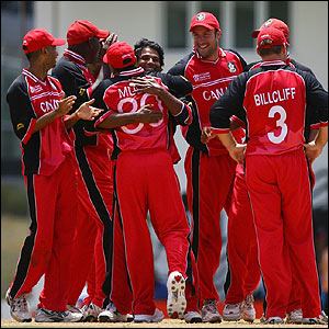 Sunil Dhaniram is congratulated by his Canada team-mates after dismissing Kevin Pietersen