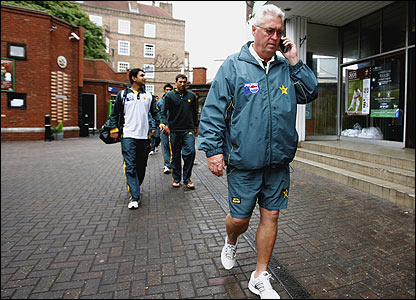 Woolmer chats on the phone at the Oval after Pakistan forfeit a Test match