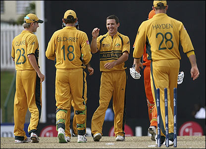 Brad Hogg is congratulated by his Australian team-mates