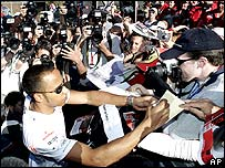 Lewis Hamilton signs autographs after the Australian Grand Prix