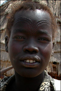 Dinka woman with traditional facial scars