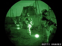Using infrared lasers only seen with night vision goggles, US Marines search for insurgents in Ramadi