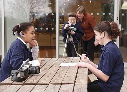 Sophie and Ruby decide on questions while Jade and teacher Sylvia Simmonds set up the shot (Photo: Peter Sumpter)