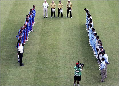 Bermuda and India players and match officials observe two minute's silence