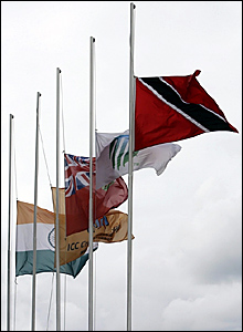 Flags fly at half mast at the Queens Park Oval Cricket Ground in Trinidad