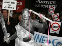Solicitor Sally Middleton, dressed as Lady Justice, joins the protest