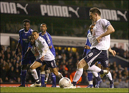 Robbie Keane slots home a penalty for Spurs