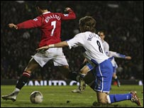 Cristiano Ronaldo is felled by Jonathan Woodgate