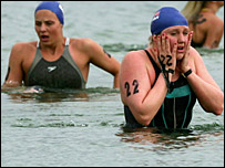 Cassie Patten (right) recovers after the 10km open water event