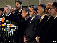 Ismail Haniya (left) presents his new cabinet