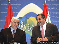 Syria's Foreign Minister Walid al-Moualem (left) and Iraq's Foreign Affairs Minister Hoshiyar Zebari