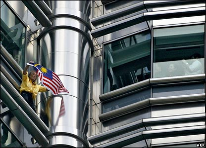 Alain Robert climbs the Petronas Twin Towers in Kuala Lumpur