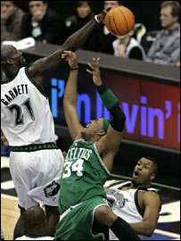 Minnesota's Kevin Garnett blocks Celtics star Paul Pierce's shot