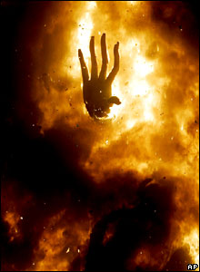 The hand of a papier-mache model burns at Las Fallas festival in Valencia, Spain