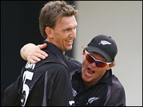 Michael Mason (left) celebrates an early wicket