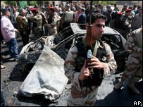 Iraqi soldier in front of a car bomb