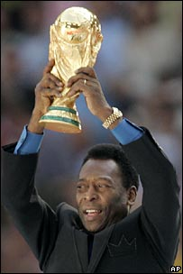 Pele holding the 2006 World Cup trophy