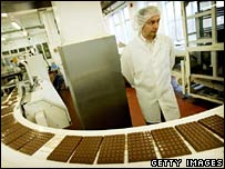 Worker overseeing production line