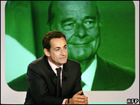 Nicolas Sarkozy on Canal Plus TV next to image of President Chirac (file picture)