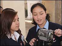 Students learn how to use a camera