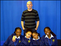 Head of BBC News Interactive Pete Clifton with teenagers from Brooke School, Lambeth