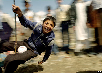 A boy enjoys a fairground ride in Kabul on Noruz