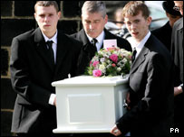 David Mullen (right) carries his daughter's coffin into the church